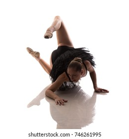 """woman ballerina in black pack posing on white background photo made in the style of """"low key"""""""