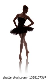 "woman ballerina in black tutu posing on white background photo made in the style of ""low key"""
