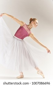 woman ballerina in full growth on a light background, art, dance