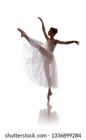 """woman ballerina in white long skirt posing on white background photo made in the style of """"low key"""""""