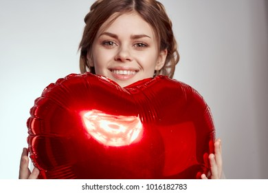 Woman with a balloon in the shape of a heart