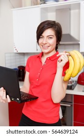 Woman with bananas and laptop