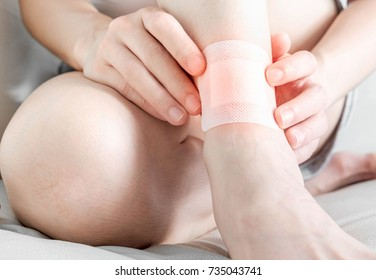 woman with a bandage on ankle wound.Selective focus,Human health care and medicine concept.
