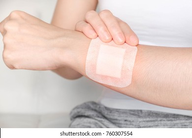 woman with a bandage on arm,  chest.Selective focus,Human health care and medicine concept.