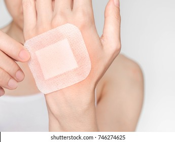 woman with a bandage on hand.Selective focus,Human health care and medicine concept.