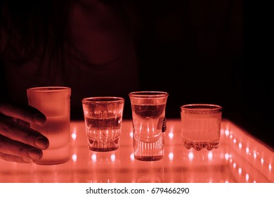 woman in a bar or club with glass of alcohol drink