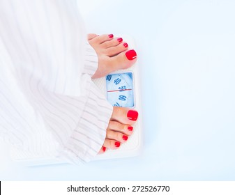 Woman barefoot standing on scales, 50 kilogram, body part, healthy lifestyle and nutrition, result of diet and fitness, weight loss concept
