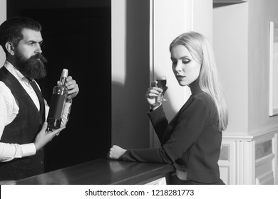 Woman and bartender at bar. Girl with long blond hair drinking wine served by barman at counter. Alcohol, appetizer and aperitif. Addictive and convive. Unhealthy lifestyle. Bad habits
