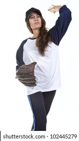 Woman baseball or Softball player isolated on white pitches or  throws a baseball.