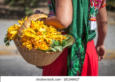 Woman with a basket in ethnic traditional Mexican dress, Latin America. Travel background for Mexico.