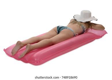 Woman in bathing bikini relaxing on air matress