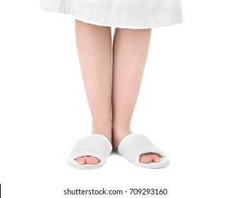 Woman in bathing slippers on white background