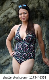 Woman in Bathing suit. A young woman enjoys a vacation on the beach. Southern California Beach vacation. Laguna Beach California.