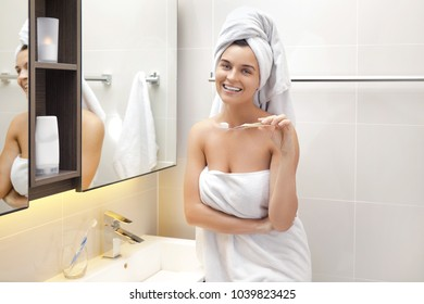Woman  in the bathroom during her daily tooth brushing routine