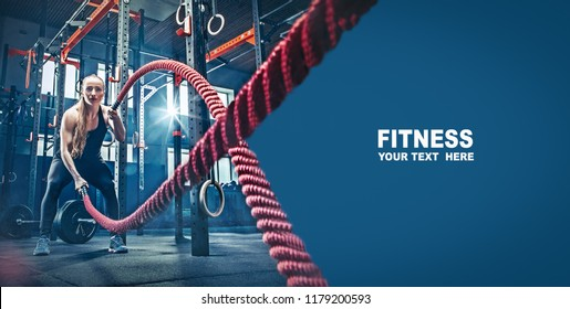 Woman with battle rope battle ropes exercise in the fitness gym. gym, sport, rope, training, athlete, workout, exercises concept