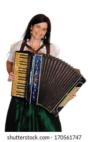 Woman in bavarian dirndl with accordion in front of a white background