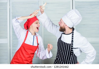 Woman and bearded man culinary show competitors. Ultimate cooking challenge. Culinary battle of two chefs. Couple compete in culinary arts. Kitchen rules. Who cook better. Culinary battle concept.