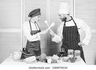 Woman and bearded man culinary show competitors. Who cook better. Ultimate cooking challenge. Culinary battle of two chefs. Couple compete in culinary arts. Kitchen rules. Culinary battle concept.