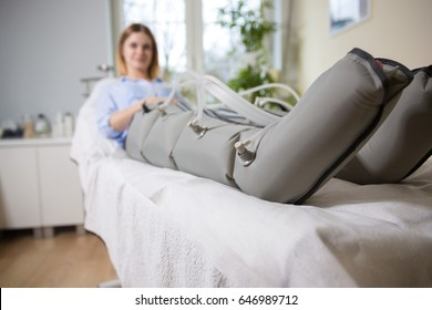 Woman at beautician's during firming hypotensive massage