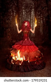Woman in a beautiful dress on fire