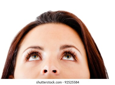 Woman with beautiful eyes looking up - isolated over a white background