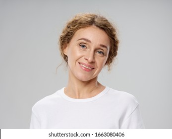 A woman with a beautiful face is an old age and cropped look