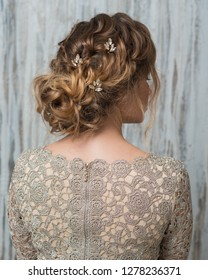 Woman with beautiful hairstyle decorated by crystal shiny hair accessory, rear view