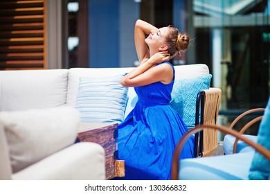 woman at beautiful interior outdoors at hotel lobby