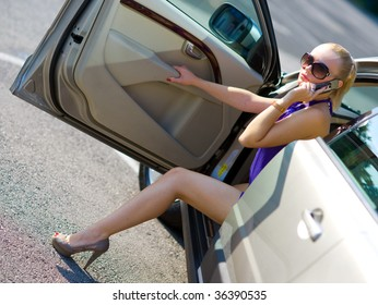 woman with beautiful legs exit the car
