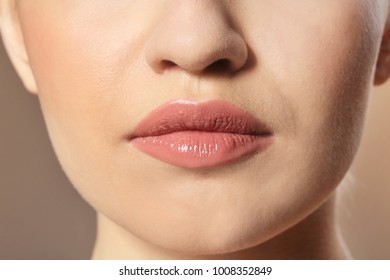 Woman with beautiful makeup on color background. Professional visage artist work