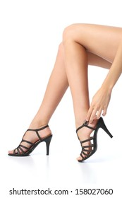 Woman with beautiful smooth legs touching the heel of the foot isolated on a white background
