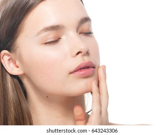 Woman beauty face closed eyes with hand portrait isolated on white with healthy skin. Studio shot. Isolated on white.