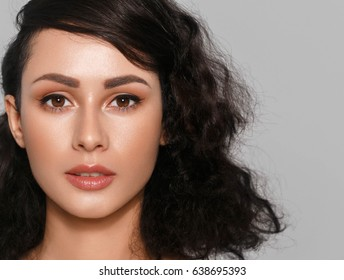 Woman beauty face closeup with many curly black hair portrait isolated  with healthy skin. Studio shot.