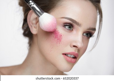 Woman Beauty Face Cosmetics. Portrait Of Sexy Young Female Model Applying Makeup, Loose Blush With Brush On Facial Skin. Closeup Beautiful Girl With Fresh Skin And Natural Make-Up. High Resolution