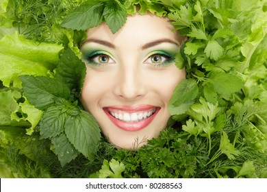 woman beauty face with greens vegetables frame