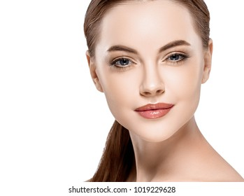 Woman beauty face portrait isolated on white with healthy skin. Studio shot.