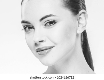 Woman beauty face portrait isolated on white with healthy skin. Studio shot. Monochrome