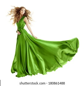 Woman in beauty fashion green gown, beautiful girl dancing in long evening dress, turning on white background