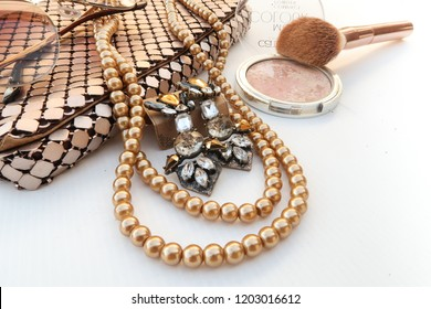 Woman beauty golden accessory fashion set and makeup on white background