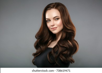 Woman beauty healthy skin and hairstyle, brunette with long hair over dark background female portrait.