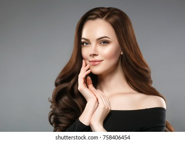 Woman beauty healthy skin and hairstyle, brunette with long hair over dark background female portrait. Studio shot.