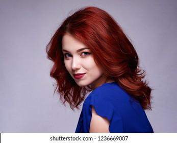 Woman with beauty long brown hair - posing at studio.