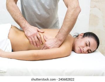 Woman in a beauty salon doing massage