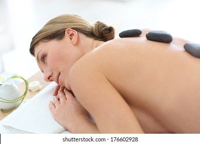 Woman in beauty salon having hot stones massage