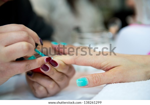 Woman in a beauty salon making nails.