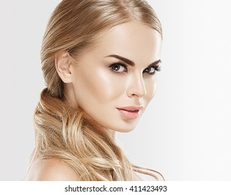 Woman beauty skin care close up portrait blonde hair studio on white