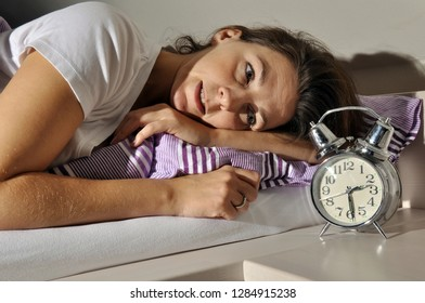 Woman in bed can not sleep and is sleepless because of worries, fears and depression