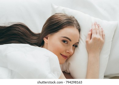 Woman in bed sleeping relax alone at home bed sleep