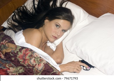 Woman in Bed Under Covers Gun Under Pillow Floral Comforter