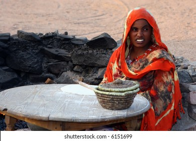 The woman - Bedouin  makes  traditional flat cakes of a flour . Marsa Alam. Egypt